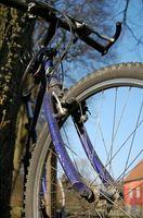 Comment faire pour mettre la roue à l'Axel Bike